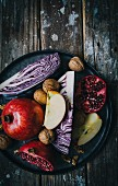 Ingredients for red cabbage salad with apple, walnuts and pomegranate seeds