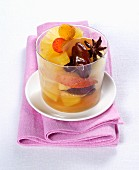 An exotic fruit salad with pineapple, dates and arbutus berries