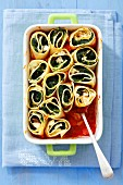 Pasta rolls with spinach and feta baked in tomato sauce