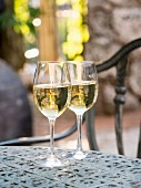 Two glasses of Albarino white wine served at a vineyard in Galicia, Spain