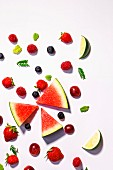 Assorted fresh fruits on a white background (a symbolic image for dieting)
