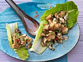 Asian chicken on a lettuce leaf