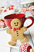 Gingerbread man and red mug