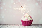 Pink birthday cupcake with sparkler