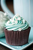 Cupcake decorated with sugar snowflakes
