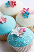 Cupcakes decorated with embossed fondant and sugar flowers