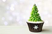 Christmas tree cupcake with copy space to side