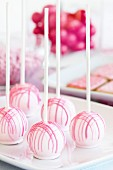 Cake pops on a dessert table