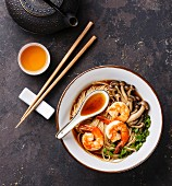 Asian Ramen noodles with prawns, shimidzhi mushrooms and green onions in broth