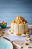 A cake with white chocolate buttercream icing and cinnamon toffee popcorn