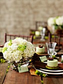 Bouquet of white hydrangeas on rustic wedding table