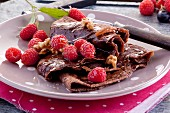 Chocolate crêpes with raspberries, walnuts and maple syrup