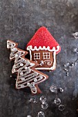 Christmas gingerbread biscuits in the shape of a house and a Christmas tree