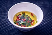 Vinaigrette with chives in a bowl