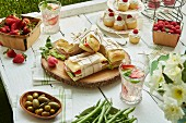 Sandwiches, salads, fruit and cupcakes for a picnic