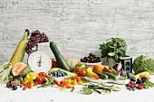An arrangement of summer vegetables and fruit