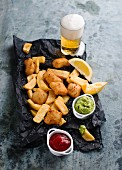 Fish and chips with avocado cream and ketchup