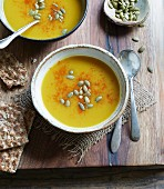 Butternut squash soup with pumpkin seeds and crispbread