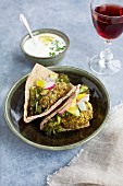 Charred broccoli falafel, charred broccoli, veggies and charred lemon tzatziki with red wine