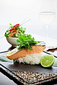 Roast salmon on a bed of rice with lime