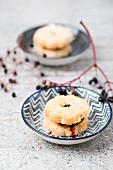 Biscuits filled with elderberry jelly