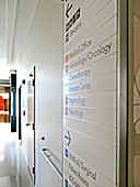 Direction Sign in Hallway of Hospital