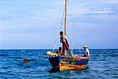 Fishermen return to port