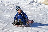 Sledding on a Snowy Hill near Boise