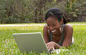 Teenage Girl Communicating through Laptop