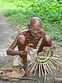 Old Villager Plaiting a Basket