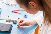 Technician assembling a sensor