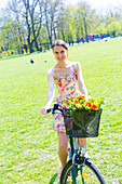 Woman on bicycle in a park in summer