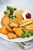 Chicken nuggets,chips and salad