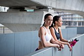 Women in sports clothing resting