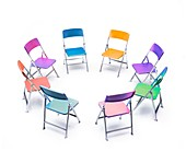 Circle of chairs of different colours