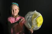 A girl pops a Balloon