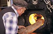 Stoking a boiler