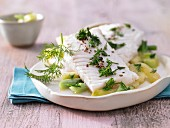 Steamed fillet of haddock on a bed of cucumber with dill yoghurt