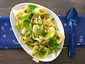 Flat ribbon pasta with Brussels sprouts, capers and parsley pesto
