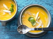 Creamy potato and carrot soup with white asparagus