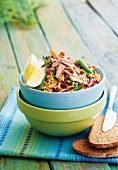 Quinoa salad with tuna, radicchio, beans and dried tomatoes