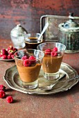 Chocolate mousse made with chocolate, greek yogurtand whipped egg whites with raspberries