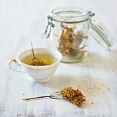 Elderflower tea in a cup with dried elderflower