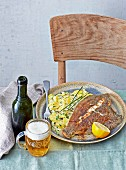European plaice with potato salad served with beer