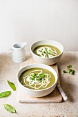 Spinach and watercress soup with cream and black pepper