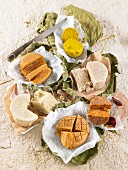Different types of vegan cheese seasoned with argan oil, curry powder and turmeric