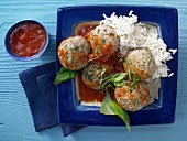 Basil and veal dumplings with tomato sauce and rice