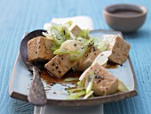 Steamed silk tofu with ginger and spring onions