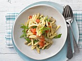 Olive and tomato macaroni with rocket