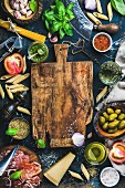 Italian food cooking ingredients on dark background